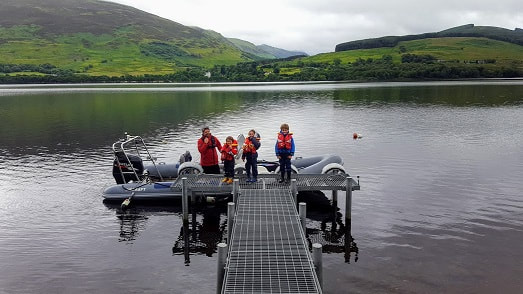 Guest rib tied at Briar Cottages jetty Loch Earn