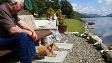 Briar Cottages Loch Garden with Maisy the dog and Billy enjoying Loch Earn