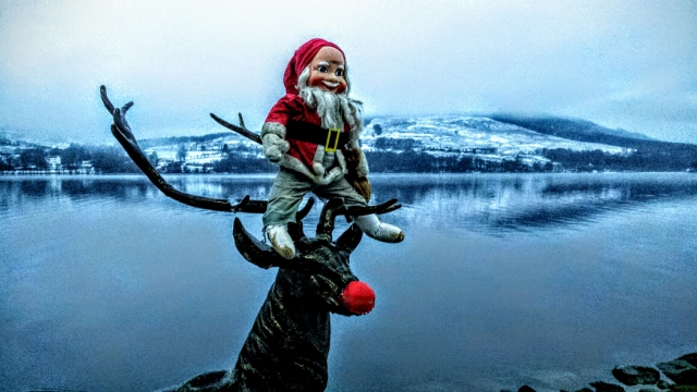 Wee santa poses with Rudolph