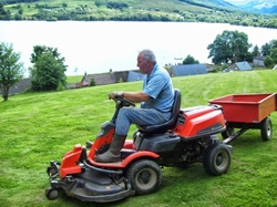 Frasers Lawnmore -cutting the paddock at Briar Cottages