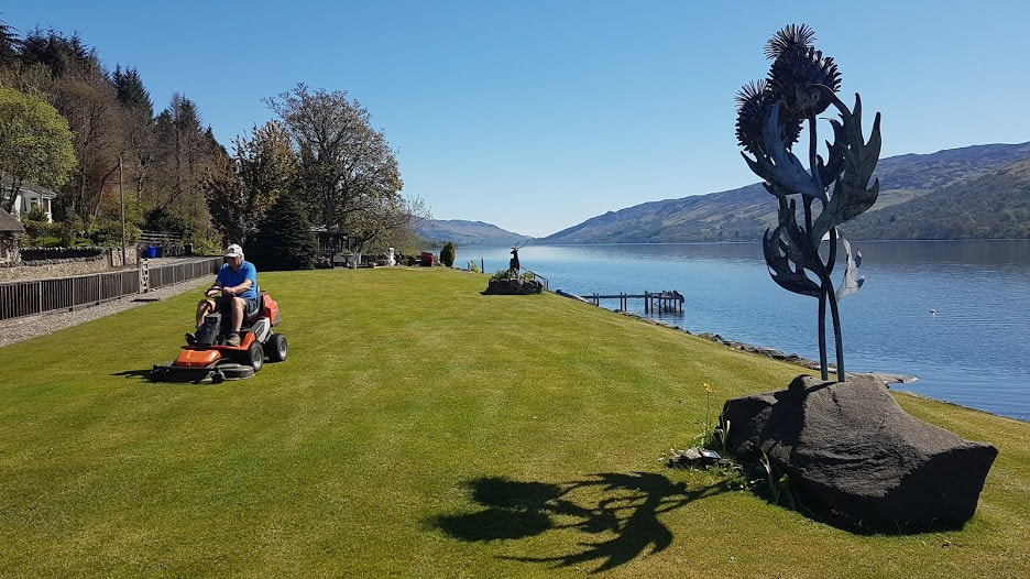 Fraser cutting the grass for putting, Loch Earn