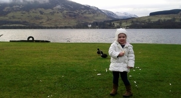 Little Emily feeding mallards at Briar Cottages