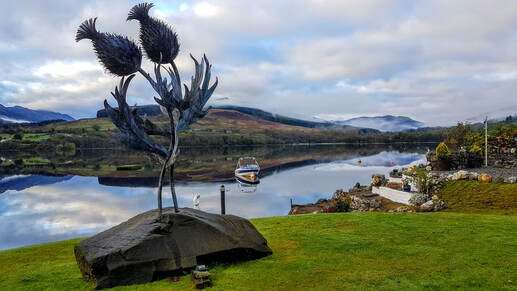Thistle sculpture by Kev Paxton, Briar Cottages garden Loch Earn