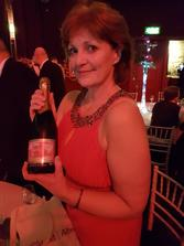 Kim Proven with Prestonfield House Champagne to celebrate LETi tourism groups 2nd Scottish Regional Thistle Award for tourism