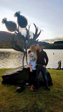 Couple get engaged at the thistle sculpture in Briar Cottages garden Loch Earn