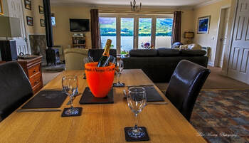 Briar Staading luxury lounge and view of Loch Earn