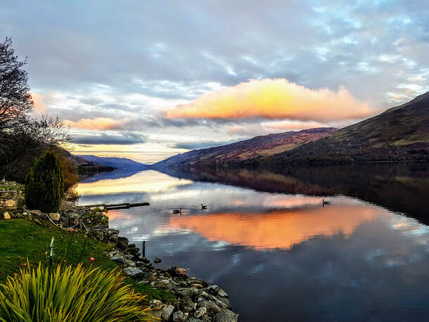 Romantic scene, tangerine clouds over Loch Earn from Briar Cottages