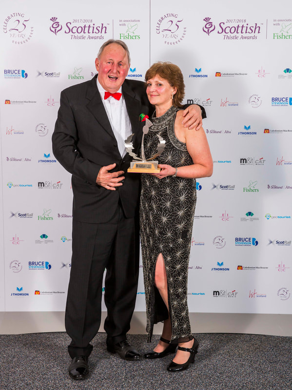 PicFraser and Kim with the National Scottish Thistle Award on behalf of LETi fror Innovation In Tourism -BLiSS trail 2017